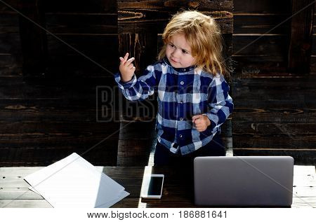 small cute business boy with phone and computer in office with paper sheet