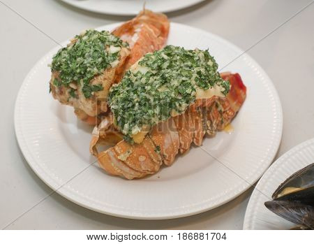 Lobster tail with Garlic Butter dressing .