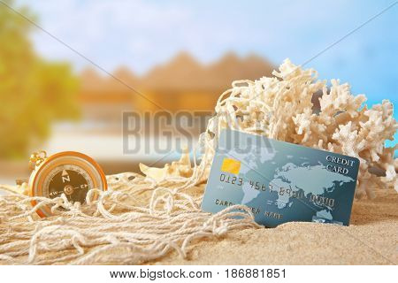 Travel concept. Credit card and resort on background
