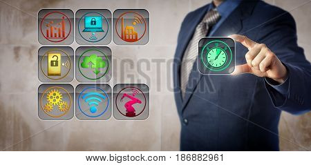 Blue chip manufacturing manager is plugging a stopwatch into an operational control interface. Concept for real time data collection machine uptime capacity utilization and equipment effectiveness.