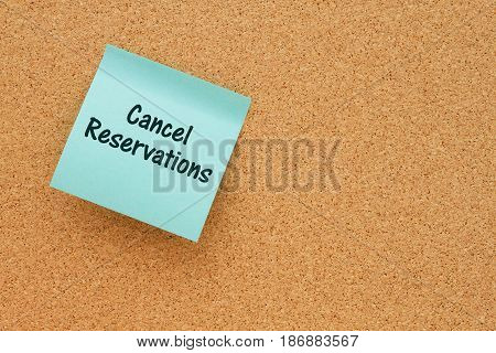 A reminder to cancel reservations Bulletin board with a teal sticky note with text Cancel Reservations