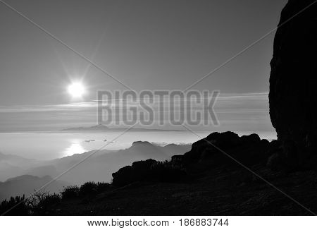Sunset from summit of Gran canaria and Tenerife island in the distance, Canary islands, monochrome mode