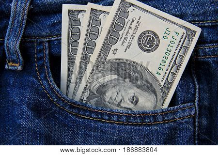 American dollar banknotes in the jeans pocket