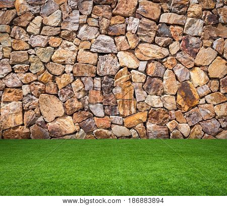green grass or turf with brown stone background