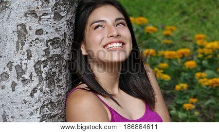 A Young Hispanic Pretty Teen Girl Daydreaming