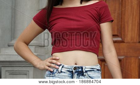 Slender Girl And Waist with Hand on Hips