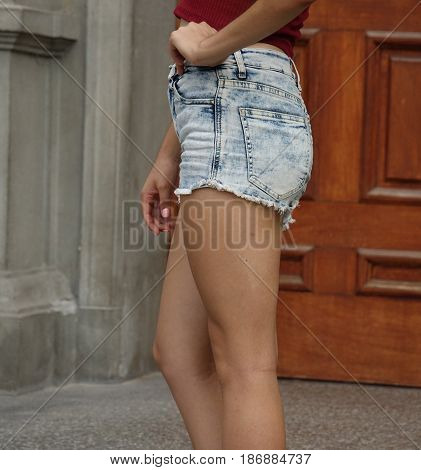 Legs Of Thin Teen Girl Wearing Jean Shorts