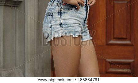 Legs Of Female Teen Wearing Jean Shorts