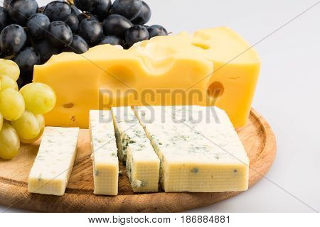 Cheese cheese plate cheese platter cheese tray cheese board grape isolated on white