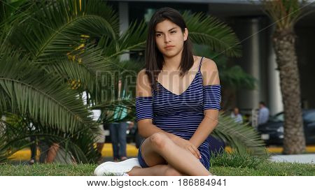 Unhappy And Serious Person Sitting on Grass