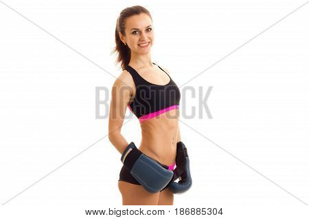 Fitness girl sports top sagged in the back looks into the camera and smiling isolated on white background