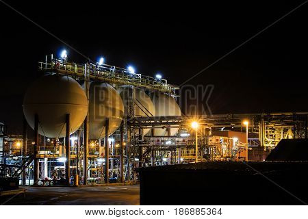 Hydrochloric acid tanks of petrochemical refinery at night. Tessenderlo Flanders Belgium Europe