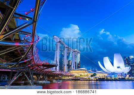 SINGAPORE MAY 14 2017 : Helix Bridge DNA Marina Bay Sands and Artscince Museum  it's most famous and popular place of tourists at Merlion park and Marina Bay in twilight sunset