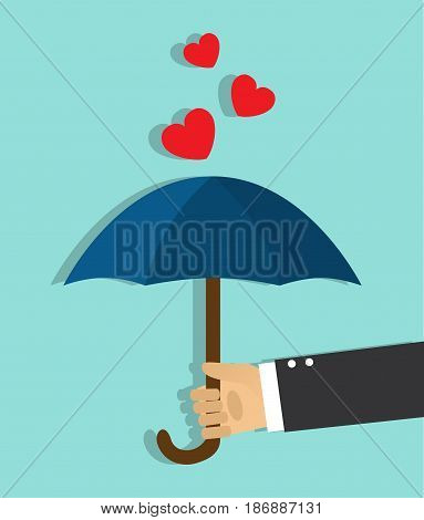 The hand holds the open umbrella and the hearts do not get on top of the umbrella