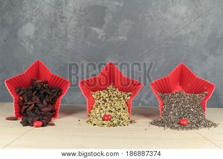 Chia seeds, hemp seeds and goji berries/ These are chia and hemp seeds and goji berries in red star bowls.