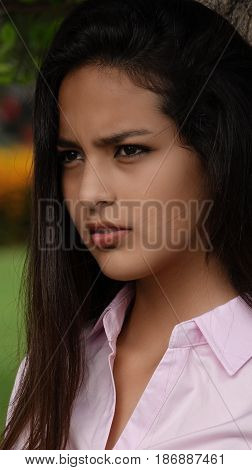 Pretty Female Teen Wearing a Pink Shirt