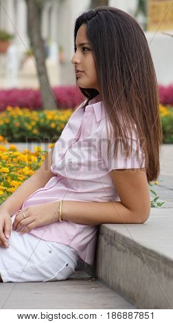 Teen Girl Relaxing and Sitting in Park