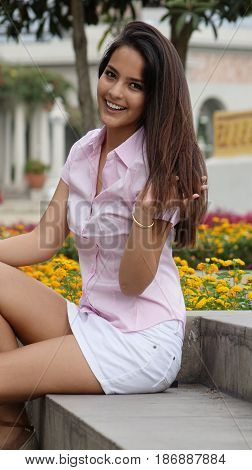 Happy Teen Girl Sitting in Public Park