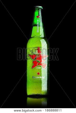London, Uk - May 15, 2017: A Bottle Of Heineken Beer World Edition On Black. Heineken Is The Flagshi
