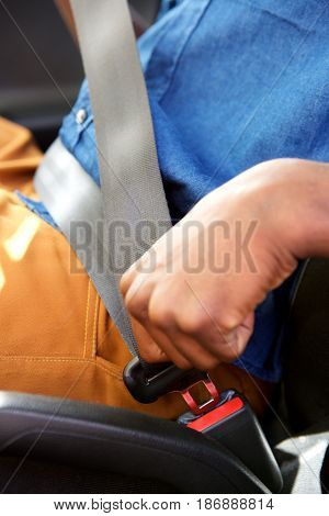 Man Fastening A Seat Belt In The Car