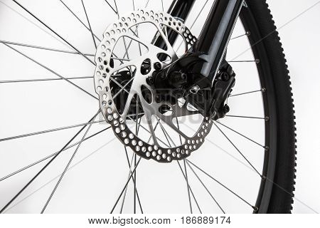 Closeup of disk brake of a mountain bicycle.