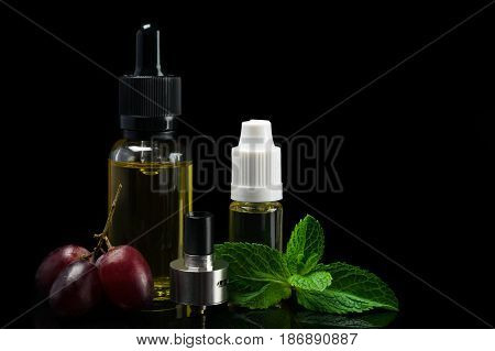 cistern from an electronic cigarette and flavors of fruit flavors a concept on a black background