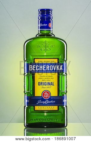 Bottle of Becherovka on gradient background. Becherovka is herbal bitters produced in Karlovy Vary in Czech Republic by Jan Becher company since 1807