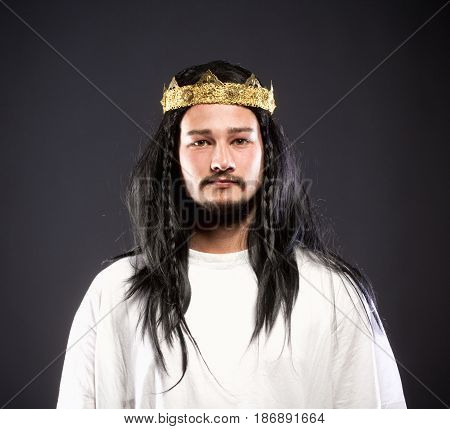 Portrait of a King with Crown and Dark Hair.