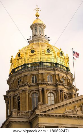 The US and State flags fly at the Des Moines Capital