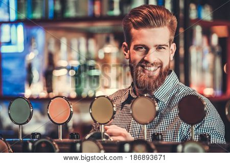Young Bearded Bartender.