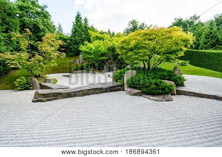japanese zen garden with trees in the background
