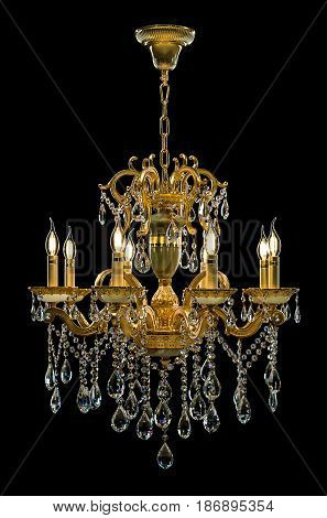 Contemporary gold chandelier isolated on black background. Crystal chandelier.
