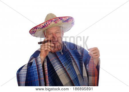 A man wears a Mexican Sombrero, a Serape or Poncho and smokes a big cigar as he celebrate a Mexican holiday or tradition. Isolated on white, Room for text.