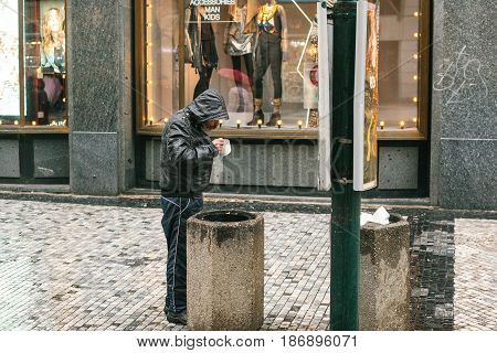 Prague, Czech Republic - December 24, 2016 - The homeless, the hungry, the poor man have trash in the city centre. Dirty poor people