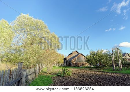 Autumn view of the village house from the garden. Somewhere in the European part of Russia.