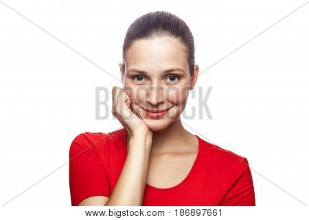 Portrait of happy smiley woman in red t-shirt with freckles. looking at camera studio shot. isolated on white background.