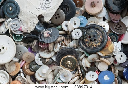 Buttons in tin cans found in an antique store