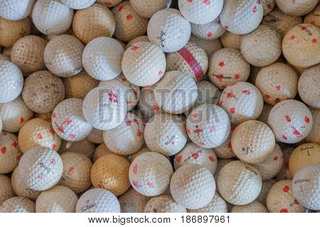 HOT SPRINGS VIRGINIA- MAY 7 2017: Basket full of golf balls found in an antique store.