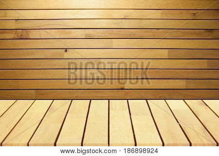 Wooden desk and wooden wall. Mock up for display of products.