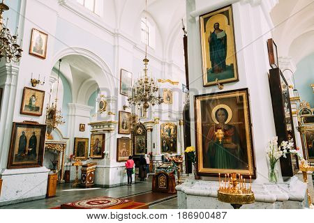 Minsk, Belarus - September 3, 2016: Parishioners praying in Cathedral Of Holy Spirit In Minsk. Main Orthodox Church Of Belarus And Symbol Of Old Minsk. Famous Landmark
