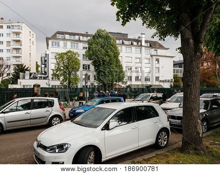 STRASBOURG FRANCE - APR 27 2017: entrance of the school kindergarten with parents queue to take kids out from the school - traffic jam near French school every afternoon and evening