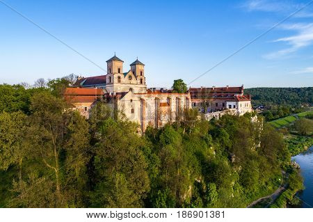 Benedictine abbey on the rocky hill in Tyniec near Cracow, Poland and Vistula River. Aerial view at sunset
