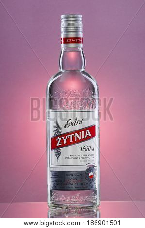 Extra Zytnia vodka on gradient background. This traditional polish luxury vodka is produced in Polmos Bielsko-Biała, Poland. It has been produced since 1827.