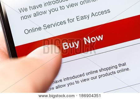 smartphone touch screen with red button. business e-commerce concept.