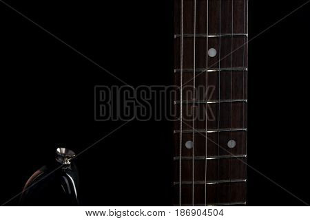 Music And Art. Electric Guitar On A Black Isolated Background. Horizontal Frame