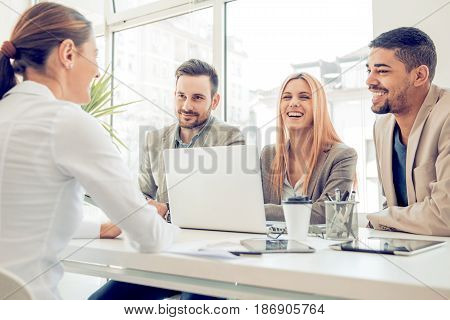 Group of business people having job interview. Young attractive woman during job interview.