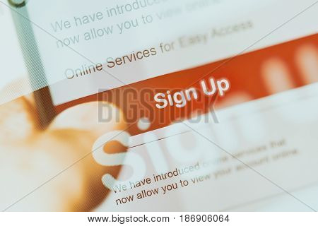 smartphone touch screen with red button sign up. business e-commerce concept.