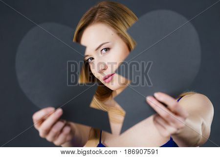 Young Sad Woman Covered By Broken Heart.