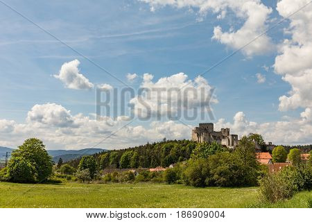 Gothic castle Rabi in south Bohemia. Ruins of gothic castle Rabi in National Park Sumava. Aerial view to medieval monument in Czech Republic. Central Europe.