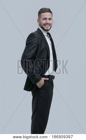 Full length smiling business man looking at camera and standing
